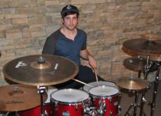 The first time I picked up a pair of drumsticks was around seventh grade when I was trying out for our school drum line. I made the cut and found that I loved playing the drums. Playing the marching snare for four years in high school helped tremendously with my technique and basic rudiments and really sparked my passion for the drums....