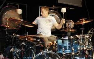 Carl Palmer playing at a drum kit