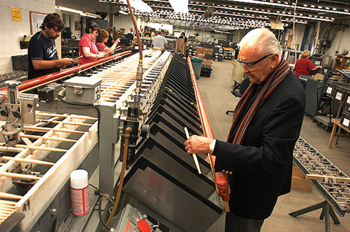 Vic inspecting drumsticks at the factory in 2003