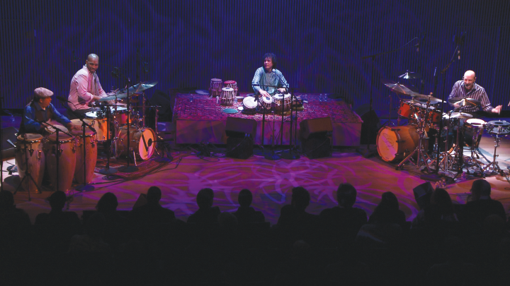 From left: Giovanni Hidalgo, Eric Harland, Zakir Hussain, and Steve Smith work out some high-level cross-cultural music on stage at the SFJazz Center, March 2013.