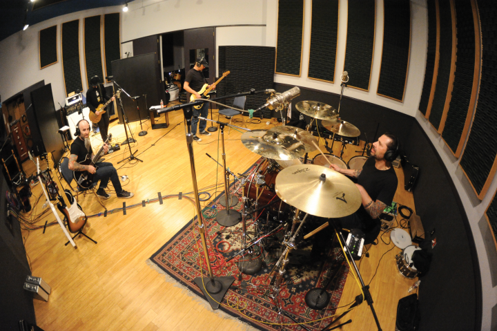 Tempesta in the studio with, from left, Scott Ian, Jim Wilson, and Joey Vera