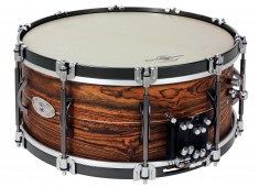 Black Swamp's 20th Anniversary snare drum features a Unibody Bocote shell, a Multisonic strainer, black-nickel hardware, straight hoops with claws, and the new Infiniti internal snare system (patent pending)....
