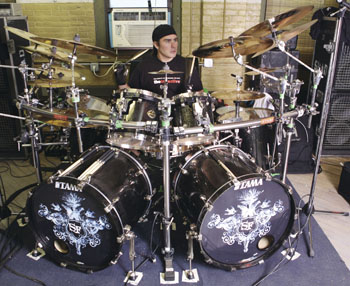 drummer Jason Bittner behind the drumkit