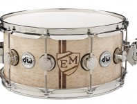"Drum Workshop has recently added a new offering to their line of Collector's Series snare drums, called Exotic Monogram. Each drum is hand-inlayed with laser-cut exotic wood veneers to comprise a ""retro shield"" design containing two personal initials...."