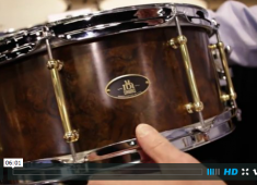 In this video from NAMM 2015 RBH Drums' Bruce Hagwood shows us an assortment of sets and snares including the new Americana Jump Kit with 13x16 bass drum and axis snare basket, the Diamond Series all hand-cut-veneer drumkit made of curly maple with cherry veneer, solid leather embossed scratch guards, and various Monarch and Prestige line snare drums....