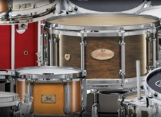 Snare drums are easily the most recognizable voice in the drumkit. The practice of studio drummers using a different snare for every song, in order to change the overall voice of the kit, shows this theory in action. Some players have signature snare sounds that identify them immediately, where others aim for less distinct tones that blend into the music. Drummers also tend to bring...
